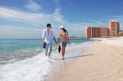 Beach with couple walking