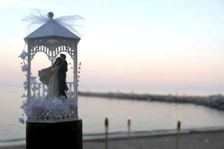 Wedding cake decoration with amazing sunset in the background